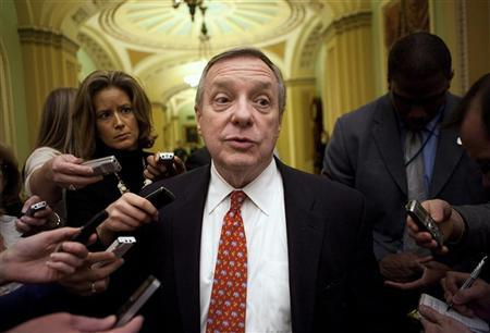 Senate Majority Whip Dick Durbin (D-NV) speaks to reporters about an agreement on the payroll tax holiday on Capitol Hill in Washington December 16, 2011. REUTERS/Joshua Roberts