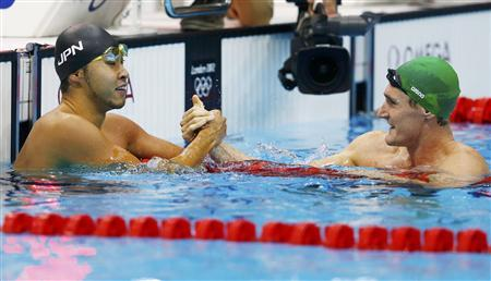 Kosuke Kitajima (L) of Japan congratulates South Africa's Cameron van der Burgh after he set an Olympic record in their men's 100m breaststroke semi-final during the London 2012 Olympic Games at the Aquatics Centre July 28, 2012. REUTERS/Michael Dalder