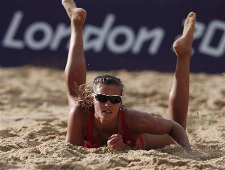Britain's Zara Dampney falls to the ground during their women's beach volleyball preliminary round match against Canada at the London 2012 Olympics Games at the Horses Guards Parade July 29, 2012. REUTERS/Marcelo del Pozo