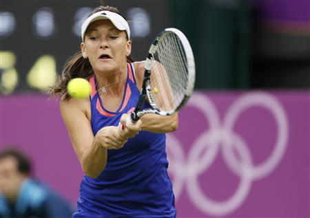 Poland's Agnieszka Radwanska returns to Germany's Julia Goerges in their women's singles tennis match at the All England Lawn Tennis Club during the London 2012 Olympics Games July 29, 2012. REUTERS/Stefan Wermuth
