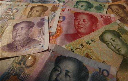 Different values of China's yuan banknotes are seen in this photo illustration taken in Shanghai April 15, 2012. REUTERS/Petar Kujundzic