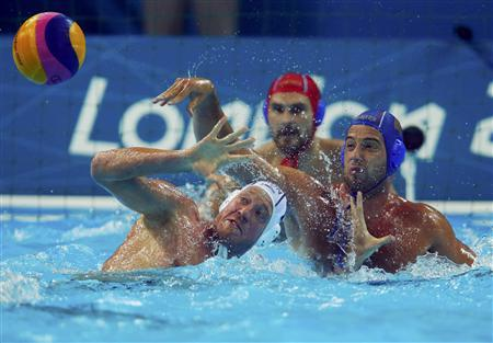 Hungary's Adam Steinmetz (L) challenges Serbia's Vanja Udovicic during their men's preliminary round Group B water polo match at the Water Polo Arena during the London 2012 Olympic Games July 29, 2012. REUTERS/Laszlo Balogh