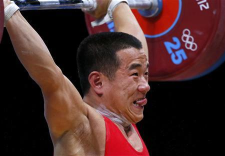 North Korea's Yun Chol Om competes on the 56Kg Group B weightlifting competition at the London 2012 Olympic Games July 29, 2012. REUTERS/Kai Pfaffenbach