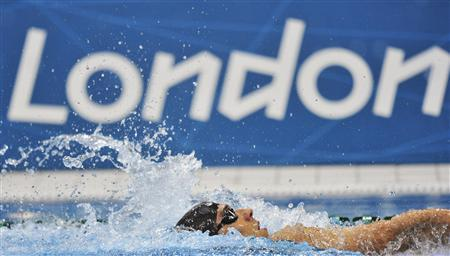 Michael Phelps of the U.S. swims during the men's 400m individual medley final at the London 2012 Olympic Games at the Aquatics Centre July 28, 2012. Phelps, a shadow of the swimmer won eight gold medals at Beijing four years ago, was unable to offer any real challenge and finished fourth, missing a medal for the first time at the Olympics since he was a 15-year-old at Sydney in 2000. REUTERS/Toby Melville