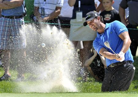Scott Piercy of the U.S. hits out of a green side bunker on the first hole during the final round at the Canadian Open golf tournament at Hamilton Golf and Country Club in Ancaster, Ontario, July 29, 2012. REUTERS/ Mike Cassese