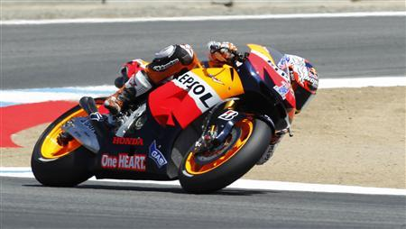 Casey Stoner of Australia accelerates during his second place qualifying finish at the U.S. Grand Prix Moto GP world championship motorcycle race in Monterey, California July 28, 2012. REUTERS/Robert Galbraith