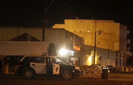 A police patrol vehicle is seen outside the Italian embassy in Sanaa July 29, 2012. REUTERS/Khaled Abdullah