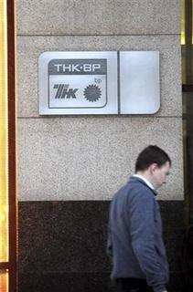 A passer-by walks past the main office of TNK-BP in Moscow February 9, 2011. REUTERS/Nikolay Korchekov