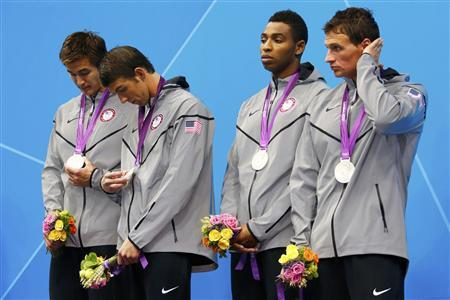 Nathan Adrian, Michael Phelps, Cullen Jones and Ryan Lochte of the U.S. stand with their silver medals in the men's 4x100m freestyle relay victory ceremony during the London 2012 Olympic Games at the Aquatics Centre July 29, 2012. REUTERS/David Gray
