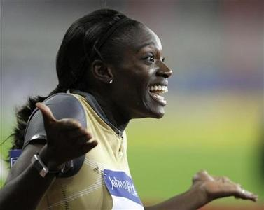 Dawn Harper of the U.S. reacts upon hearing the results of the women's 100m hurdles race at the Shanghai Golden Grand Prix September 20, 2009. REUTERS/Aly Song