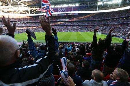 Britain's supporters watch their men's preliminary first round Group A soccer match against UAE at the London 2012 Olympic Games in the Wembley Stadium in London July 29, 2012. REUTERS/Eddie Keogh