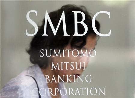 A woman walks out from a branch of Sumitomo Mitsui Banking Corporation in Tokyo July 30, 2012. REUTERS/Yuriko Nakao