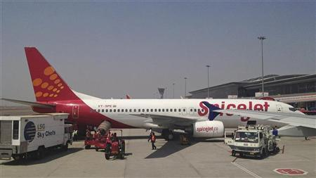 A SpiceJet Boeing 737-800 aircraft is parked on the tarmac at Rajiv Gandhi International Airport in Hyderabad March 7, 2012. REUTERS/Vivek Prakash/Files