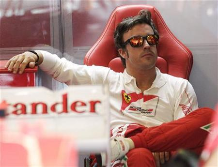 Ferrari Formula One driver Fernando Alonso of Spain waits in the pit during the third practice session for the Hungarian F1 Grand Prix at the Hungaroring circuit near Budapest July 28, 2012. REUTERS/Leonhard Foeger