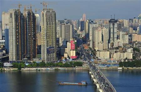 A general view of buildings is seen near the Xiangjiang River in Changsha, Hunan province July 25, 2012. REUTERS/China Daily