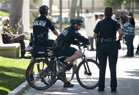 General Services Police officers stand watch as the park surrounding Los Angeles City Hall is reopened seven-and-a-half months after Occupy protesters took it over in Los Angeles, California July 19, 2012. REUTERS/Jason Redmond