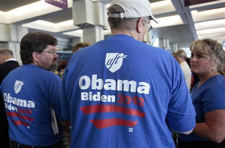 American Federation of Teachers union members wear ''Obama, Biden 2012'' shirts as they wait in line to hear U.S. Vice President Joe Biden speak during their AFT convention in Detroit, Michigan, July 29, 2012. REUTERS/Rebecca Cook