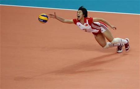 China's Zhang Xian tries to save a spike by South Korea during the women's volleyball final at the 16th Asian Games in Guangzhou, Guangdong province, November 27, 2010. REUTERS/Bobby Yip