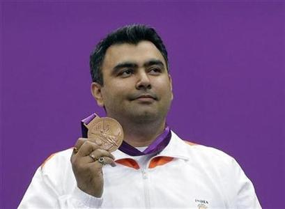 India's Gagan Narang poses with his bronze medal during the 10m air rifle men's victory ceremony at the Royal Artillery Barracks during the London 2012 Olympic Games July 30, 2012. REUTERS/Cathal McNaughton