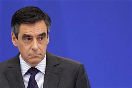 France's Francois Fillon, delivers a speech as he attends a news conference at the Hotel Matignon in Paris January 14, 2012. REUTERS/Benoit Tessier