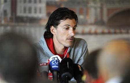 Swiss cyclist Fabian Cancellara speaks to reporters at a news conference at The Mitre Hotel in Hampton, London July 30, 2012. Olympic time trial champion cyclist Cancellara hopes to train through the pain in his bid to defend his title in London after crashing in the men's road race, he told a news conference on Monday. REUTERS/ Ki Price
