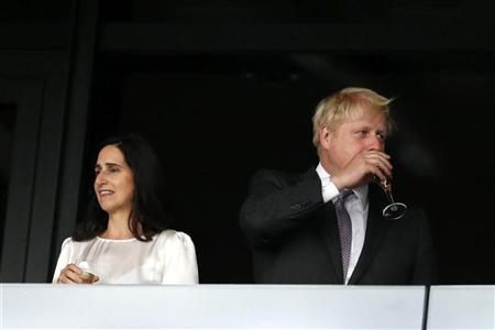 London mayor Boris Johnson (R) sips wine as his wife Marina Wheeler stands to his left in the VIP box before the opening ceremony of the London 2012 Olympic Games at the Olympic Stadium July 27, 2012. REUTERS/Suzanne Plunkett