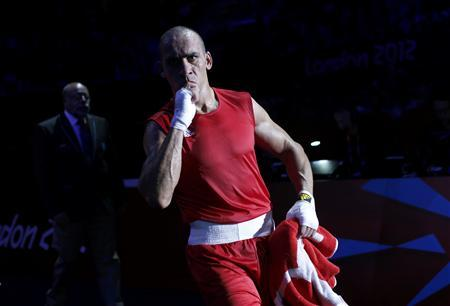 Jordan's Ihab Almatbouli reacts after he defeated Nigeria's Lukmon Lawal in the men's Light Heavy (81kg) Round of 32 boxing match at ExCeL venue during the London 2012 Olympic Games July 30, 2012. REUTERS/Murad Sezer