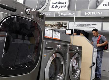 Shoppers look at washers and dryers at a Home Depot store in New York, July 29, 2010. REUTERS/Shannon Stapleton