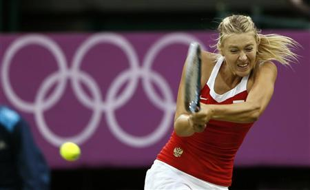 Russia's Maria Sharapova returns to Israel's Shahar Peer in their women's singles tennis match at the All England Lawn Tennis Club during the London 2012 Olympics Games July 29, 2012. REUTERS/Stefan Wermuth