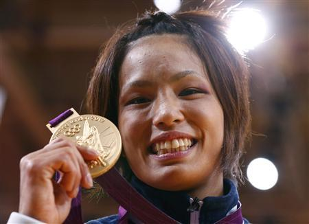 Japan's Kaori Matsumoto celebrates with her gold medal after the awards ceremony for the women's -57kg judo competition at the London 2012 Olympic Games July 30, 2012. REUTERS/Darren Staples
