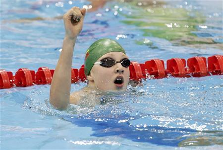 Lithuania's Ruta Meilutyte reacts after winning her women's 100m breaststroke semi-final during the London 2012 Olympic Games at the Aquatics Centre July 29, 2012. REUTERS/Tim Wimborne