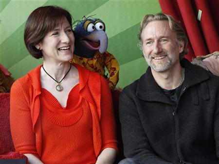 Muppet character Gonzo is pictured with Lisa Henson (L) CEO of The Jim Henson Company and her brother Brian Henson, chairman of The Jim Henson Company during ceremonies honoring the Muppets with a star on the Hollywood Walk of Fame in Hollywood, California March 20, 2012. REUTERS/Fred Prouser