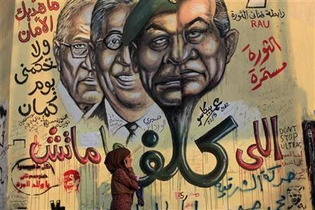 A girl walks past a mural depicting a combination of the faces of Egypt's former president Hosni Mubarak and Field Marshal Mohamed Hussein Tantawi in Cairo June 14, 2012. REUTERS/Ahmed Jadallah