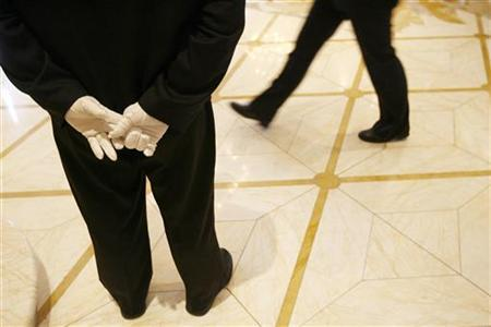 A member of the ''white glove'' hotel staff stands at attention in the lobby of ''The Plaza'' a landmark hotel as it reopens following extensive renovations in New York March 1, 2008. REUTERS/Lucas Jackson/Files