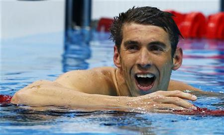 Michael Phelps of the U.S. reacts after winning his men's 200m butterfly semi-final at the London 2012 Olympic Games at the Aquatics Centre July 30, 2012. REUTERS/Michael Dalder