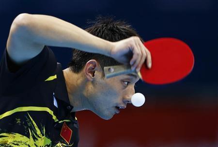 China's Zhang Jike serves to Belarus' Vladimir Samsonov in their men's singles fourth round table tennis match at the ExCel venue during the London 2012 Olympic Games July 30, 2012. REUTERS/Grigory Dukor