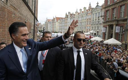 U.S. Republican Presidential candidate Mitt Romney waves to hundreds of people gathered outside before his meeting with Poland's Prime Minister Donald Tusk at the Old Town Hall in Gdansk, July 30, 2012. REUTERS/Jason Reed