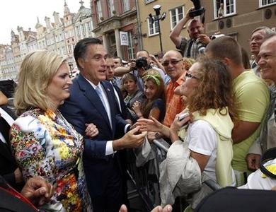Republican presidential candidate Mitt Romney and his wife Ann meet people on the street before his meeting with Poland's Prime Minister Donald Tusk at the Old Town Hall in Gdansk, Poland, July 30, 2012. REUTERS/Jason Reed