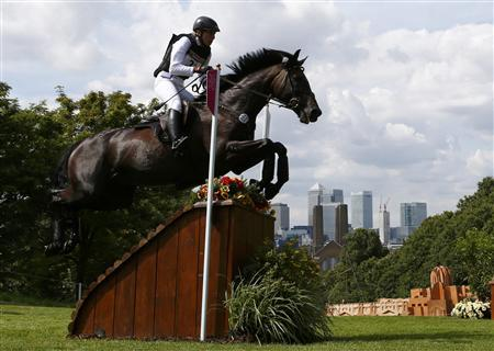 Germany's Ingrid Klimke rides Butts Abraxxas as she competes in the Eventing Cross Country equestrian event at the London 2012 Olympic Games in Greenwich Park, July 30, 2012. REUTERS/Eddie Keogh