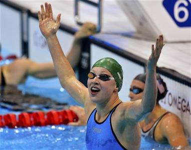 Lithuania's Ruta Meilutyte celebrates after winning the women's 100m breaststroke final at the London 2012 Olympic Games at the Aquatics Centre July 30, 2012. REUTERS/Toby Melville