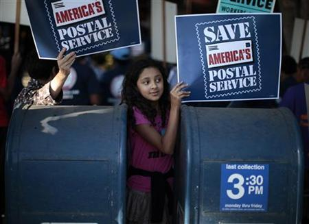 Camila Rivera, 11, joins postal workers in a national day of protest against plans to close thousands of post offices, eliminate Saturday delivery, close mail processing facilities, cut service, and lay off 120,000 employees, in Los Angeles, California September 27, 2011. REUTERS/Lucy Nicholson