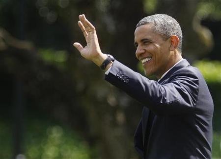 United States President Barack Obama departs the White House in Washington July 30, 2012. REUTERS/Gary Cameron