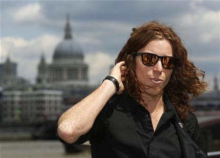 Snowboarder and Winter Olympic gold medallist Shaun White talks to Reuters about his hopes for skateboarding becoming an Olympic event, on the banks of the River Thames in London July 30, 2012. REUTERS/Luke MacGregor