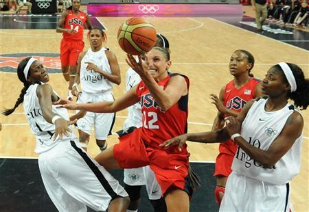Diana Taurasi (C) of the U.S. vies with Angola's Sonia Guadalupe (R) and Luisa Tomas (L) during their Women's preliminary round group A basketball match in the London 2012 Olympic Games July 30, 2012. REUTERS/Pool-Mark Ralston