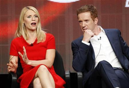 Cast member Claire Danes speaks, as co-star Damian Lewis watches, at a panel for ''Homeland'' during the Showtime television portion of the Television Critics Association Summer press tour in Beverly Hills, California July 30, 2012. REUTERS/Mario Anzuoni