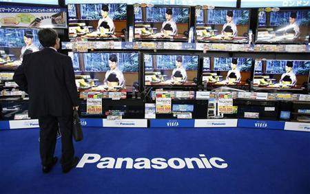 A man looks at Panasonic Corp's Viera televisions displayed at an electronic store in Tokyo June 27, 2012. REUTERS/Yuriko Nakao