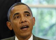 """Президент США Барак Обама на встрече в Вашингтоне, 27 июля 2012 года. Президент США Барак Обама предрек американской экономике продолжительные """"трудности"""" в течение ближайших месяцев, так как долговой кризис Европы все еще представляет собой угрозу. REUTERS/Larry Downing"""