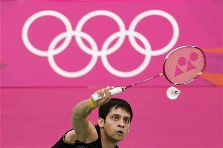 India's Kashyap Parupalli plays against Vietnam's Nguyen Tien Minh during their men's singles group play stage Group D badminton match during the London 2012 Olympic Games at the Wembley Arena July 31, 2012. REUTERS/Bazuki Muhammad