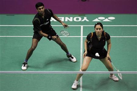 India's Jwala Gutta (R) and Diju Valiyaveetil return a shot to England's Gabrielle White and Chris Adcock during their mixed doubles match at the 2010 Badminton World Championships at the Coubertin stadium in Paris, August 23, 2010. REUTERS/Charles Platiau/Files