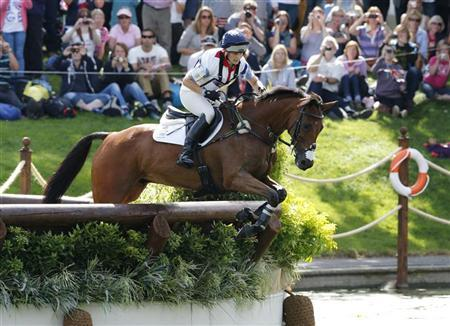 Britain's Zara Phillips rides High Kingdom as she competes in the Eventing Cross Country equestrian event at the London 2012 Olympic Games in Greenwich Park, July 30, 2012. REUTERS/Mike Hutchings